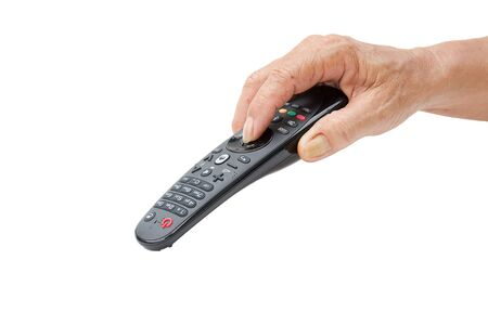 command button: old man hand with remote control isolated on white background Stock Photo