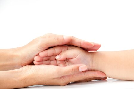 Close up of woman hand holding young man hand