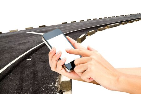 touch screen phone: hand hold touch screen on smart phone or phone on the asphalt road in background Stock Photo