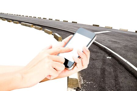 touch screen hand: hand hold touch screen on smart phone or phone on the asphalt road in background Stock Photo