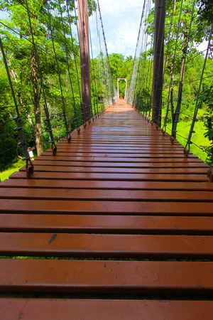 rope bridge or suspension bridge in forest at Khao Kradong Forest Park in Buriram Province,THAILAND.