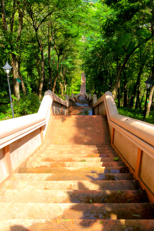 stairs for walk up and down to khao kradong volcano or Khao Kradong Forest Park. in Buriram Province,THAILAND. Stock Photo