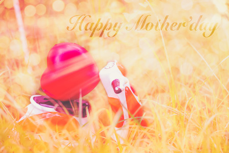 Happy Mothers Day message with a miniature motorcycle carrying a heart cushion