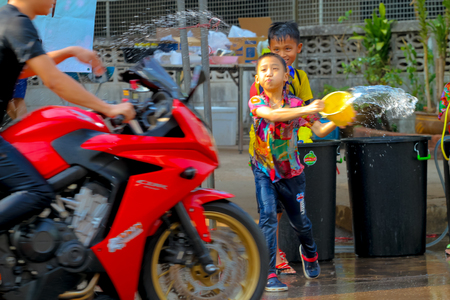 continuation: kALASIN,THAILAND - April 14, 2016:Tradition of pouring water It is a continuation of the long New Year Thailand. pour water on each other and having fun at Songkran festival, the traditional Thai New Year.popular during Songkran.Songkran is Thailands New