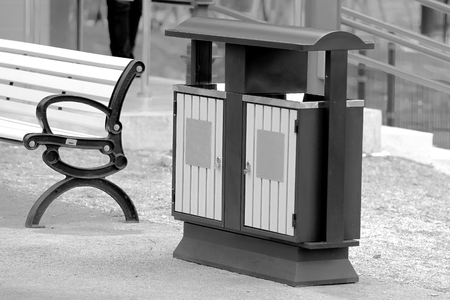 segregate: Trash or garbage can sitting on pavement in a natural park Stock Photo