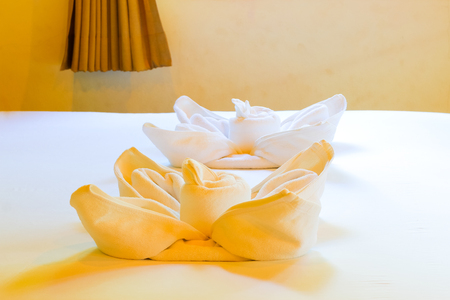 White towel on the bed Stock Photo