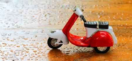 mini bike: mini motorbike on wooden floor.