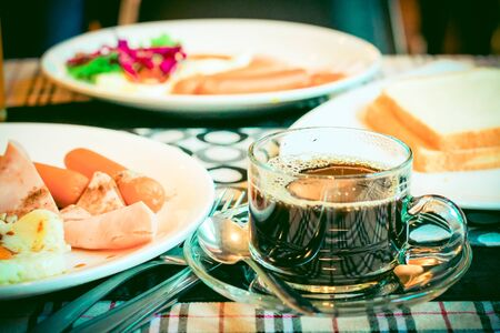 cup of coffee with breakfast food on the table Instagram vintage style