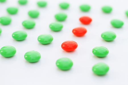 difference made Leadership :red pigment granules in the green. Stock Photo