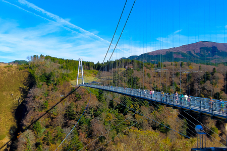 kokonoe Yume Grand Suspension Bridge Oita,Japan,  bridge float over the forested valley below, constructed at an impressive 777 meters off the ground. It is 390 meters long to cross from one side to the other, and takes on average twenty minutes to cros