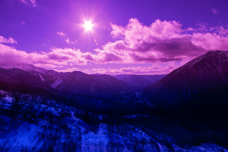 landscape of mountain covered with snow with the beautiful cloud and sky background.JAPAN Stock Photo