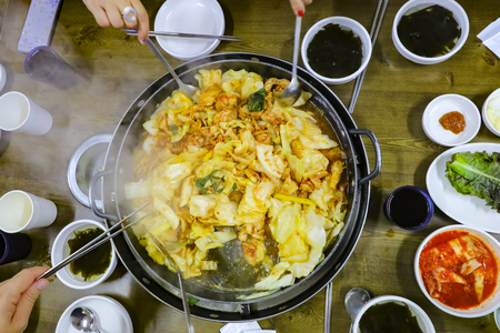 Dakgalbi : One of Korean favorite : Korean spicy stir fried vegetable, chicken and Korean spicy sauce (Gochujang) in big hot pan. 写真素材