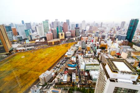 Tilt shift blur effect Osaka city landscape and city traffic across streets,JAPAN Stock Photo