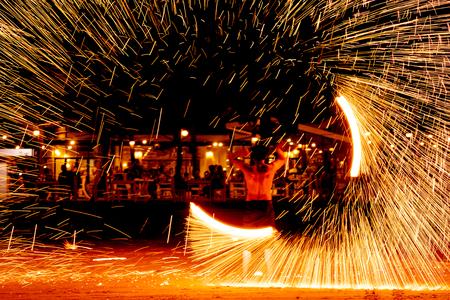 fire dance on beach near the sea , the east coast of thailand Stock Photo