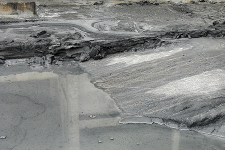 fly ash pattern during the raining and water flow Stock Photo