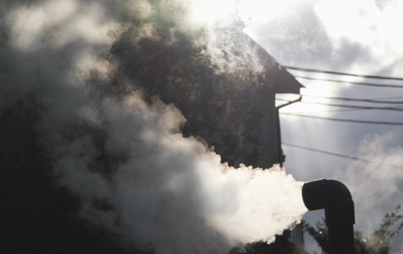 Hot steam flowing out from pipe Stock Photo