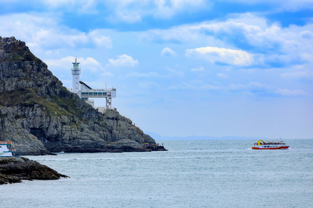 Oryukdo Islets with lighthouse and ferry boat for tourism transportation in Busan, South Korea
