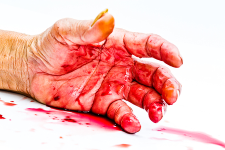 bloody hand on the table. a violence or fear horror concept. Imagens