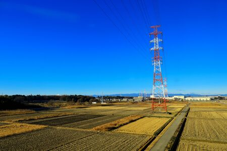 high voltage power supply tower cross along the agriculture,Japan Stock fotó