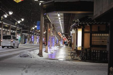 road at the night during snow fall at takayama Japan Imagens