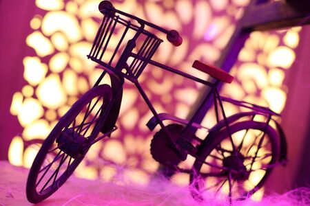 Small artistic bicycle with bright and blur background