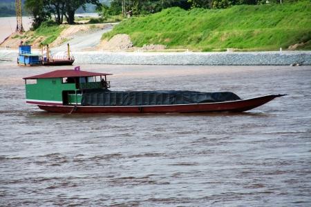 Laos cargo ship in mekong river Editorial