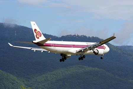 HS-TEM ,Airbus A330-300 Thaiairway TG102 landing to chiangmai airport, from bangkok. Stock Photo - 15485278