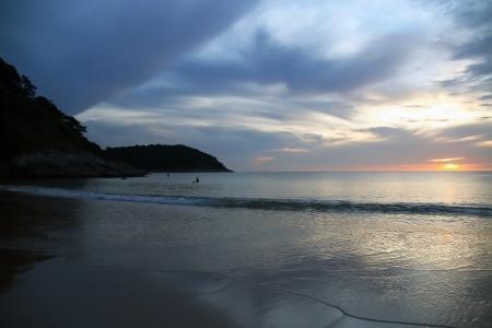 sunset at naihan beach, phuket thailand  photo