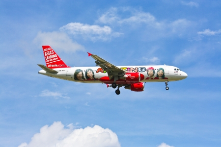 Special paint of airbus A320-200 Airasia, photo from chiangmai airport. Stock Photo - 18928456