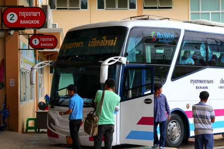 bus station: Bus and passenger, chiangmai bus station Editorial