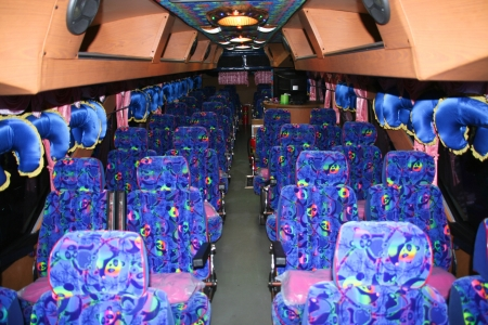 inside of a bus with seats  photo