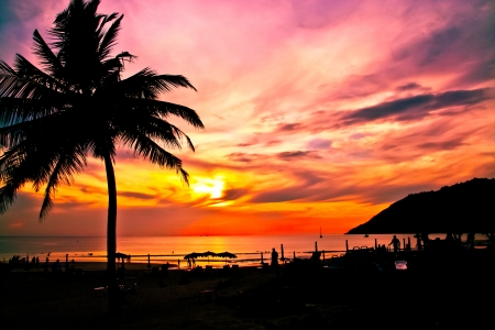Sunset at naiharn beach, phuket island, thailand  photo