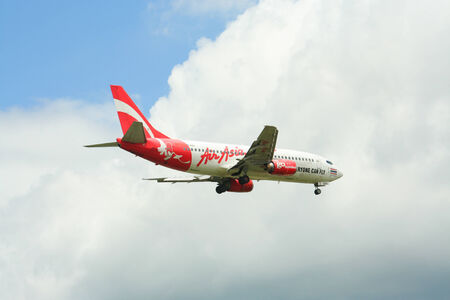 aas: CHIANGMAI    THAILAND - July 9 2009  HS-AAS Boeing 737-300 of  Thaiairasia  landing to Chiangmai airport from Bangkok Suvarnabhumi, thailand   Editorial