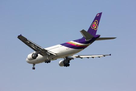 taz: CHIANGMAI    THAILAND - JANUARY 22 2014  HS-TAZ Airbus A300-600R of  Thaiairway   Landing to Chiangmai airport from Bangkok Suvarnabhumi, thailand