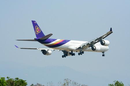 CHIANGMAI THAILAND - MARCH 31 2009 Airbus A340-600 HS-TNC Thaiairway landing to Chiangmai airport from Bangkok Suvarnabhumi, thailand