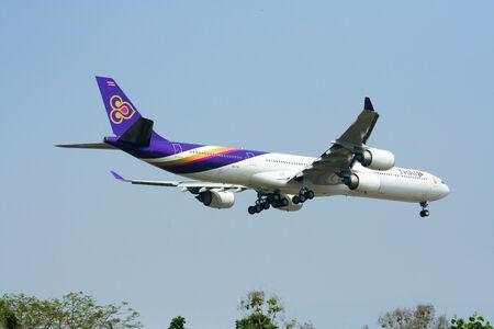 CHIANGMAI THAILAND - MARCH 31 2009 Airbus A340-600 HS-TNC Thaiairway landing to Chiangmai airport from Bangkok Suvarnabhumi, thailand Sajtókép