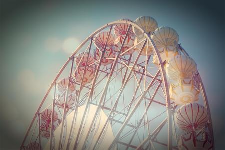 Vintage Retro Ferris Wheel on Blue Sky  Stock Photo