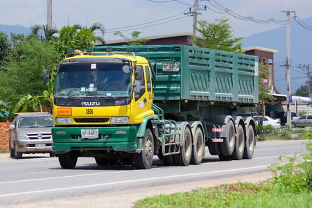 public company: CHIANGMAI, THAILAND - MAY 9 2014   Trailer dump truck of stone one public company limited  Photo at road no 121 about 8 km from downtown Chiangmai, thailand   Editorial