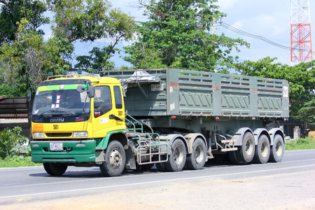public company: CHIANGMAI, THAILAND - MAY 25 2014   Trailer dump truck no 3801 of stone one public company limited  Photo at road no 121 about 8 km from downtown Chiangmai, thailand