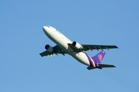 taz: CHIANGMAI , THAILAND - AUGUST 27 2009  HS-TAZ Airbus A300-600 of Thaiairway Take off from Chiangmai airport to Bangkok Suvarnabhumi