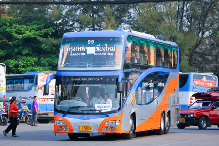 exclude: CHIANGMAI, THAILAND - APRIL 20 2014  Scania bus of Transport government no 18-1844 route Bangkok and Chiangmai, Class 2 Price exclude food and drink, not restroom  Photo at Chiangmai bus station