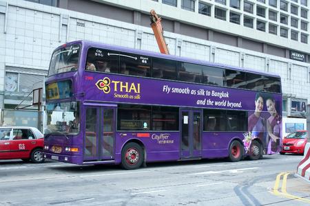 HONGKONG - OCTOBER 4 2007  Cityflyer bus between city and airport route  Thaiairway paint on side bus  Photo at road to Aiport, Hongkong, China