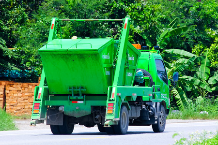 CHIANGMAI , THAILAND - AUGUST 22 2014: Garbage truck of Tonpao Subdistrict Administrative Organization. Photo at road no 121 about 8 km from downtown Chiangmai, thailand. 新闻类图片