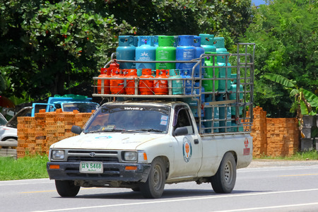 ngv: CHIANGMAI , THAILAND - AUGUST 22 2014: Gas mini truck of Picnic gas company. Photo at road no 121 about 8 km from downtown Chiangmai, thailand.