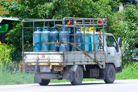 ngv: CHIANGMAI , THAILAND - AUGUST 22 2014: Gas truck of Unique gas company. Photo at road no 121 about 8 km from downtown Chiangmai, thailand. Editorial
