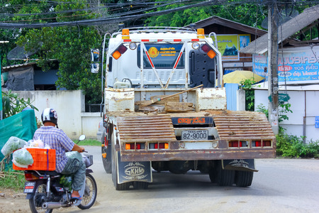 truckload: CHIANGMAI , THAILAND - SEPTEMBER 4 2014:  Truck for move bachole of Payawan company. Photo at road no.121 about 8 km from downtown Chiangmai, THAILAND.