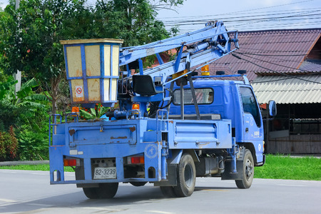 CHIANGMAI, THAILAND - SEPTEMBER 25 2014 : Bucket truck of Nongjom Subdistrict Administrative Organization. Photo at road no.121 about 8 km from downtown Chiangmai, thailand.