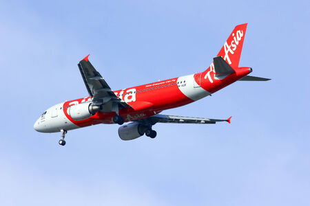 CHIANGMAI , THAILAND-SEPTEMBER 24 2014 : 9M-AQR Airbus A320-200 of Airasia. Landing to Chiangmai airport from Kuala lumpur, Malaysia.
