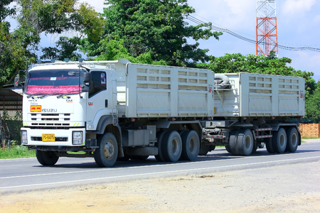 Chiangmai, Thailand - October 1, 2014: Trailer dump truck. Photo at road no.121 about 8 km from downtown Chiangmai, thailand.