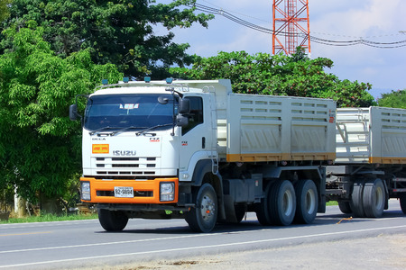 CHIANGMAI, THAILAND - OCTOBER 3 2014: Trailer dump truck. Photo at road no.121 about 8 km from downtown Chiangmai, thailand.